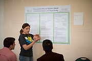 Ohio University student Barbara Wheelden presents her research to Ken Walsh (Left),  Assistant Professor of Civil Engineering and Yang Li (Right),  Associate Professor of Neuroscience at the Student Expo at the Convocation Center on Thursday, April 11, 2013. Photo by Ben Siegel