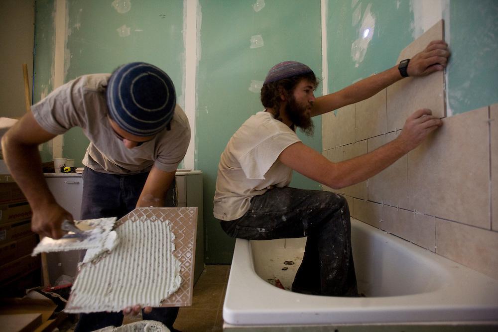 Israeli settler build a new house in the settlement of Havat Gilad.