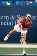 CINCINNATI, OH - AUGUST 10: Marion Bartoli of France in action against Kim Clijsters during Day 1 of the Western & Southern Financial Group Women's Open on August 10, 2009 at the Lindner Family Tennis Center in Cincinnati, Ohio. Clijsters defeated the 12th seeded Bartoli 6-4, 6-3. (Photo by Joe Robbins)