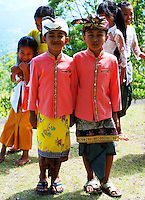 Really cute children in traditional dress at Puri Agung in Bali, Indonesia.