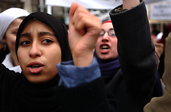 Thousands of Muslims and their supporters take to the streets in Paris, to protest against the French government's plan to ban religious attire in public schools, in Paris, France, on January 17, 2004. The proposed law would ban Muslim head scarves, (hijab) the Jewish skullcap, (yarmulke, kippah, kippot) and large Christian crosses from public schools to keep them secular and avoid religious strife. (Photo © Jock Fistick)
