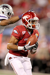 Arkansas wide receiver Jarius Wright (4) catches a pass for a touchdown during the 2012 AT&T Cotton Bowl game between Arkansas and Kansas State at Cowboy Stadium in Arlington, Tx. on Jan 6th, 2012.
