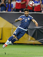 HOUSTON, TEXAS - JUNE 21: Ezequiel Lavezzi #22 of Argentina heads the ball for a goal past Brad Guzan #1 of United States during play in the first half before the Semifinal match between Argentina and US at NRG Stadium as part of Copa America Centenario US 2016 on June 21, 2016 in Houston, Texas, US. (Photo by Thomas B. Shea/LatinContent/Getty Images)