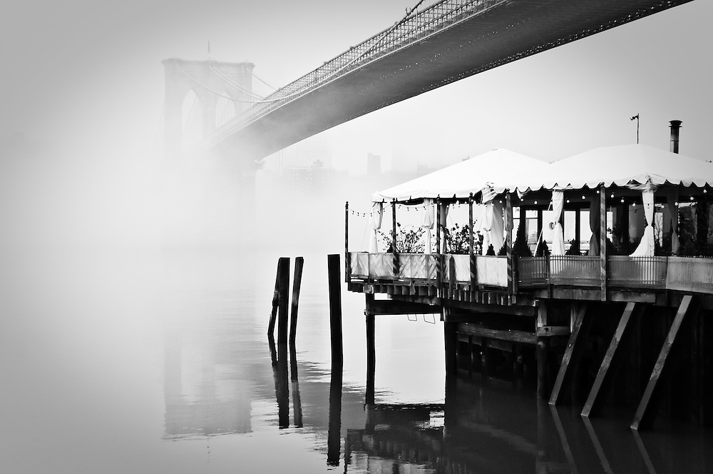 The terrasse of the River Café before the Brooklyn Bridge  on a foggy morning, Brooklyn, New York, 2010.