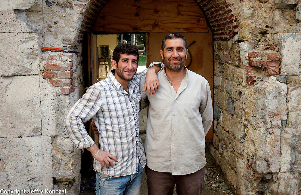 Two construction workers pose for a portrait in Istanbul, Turkey.