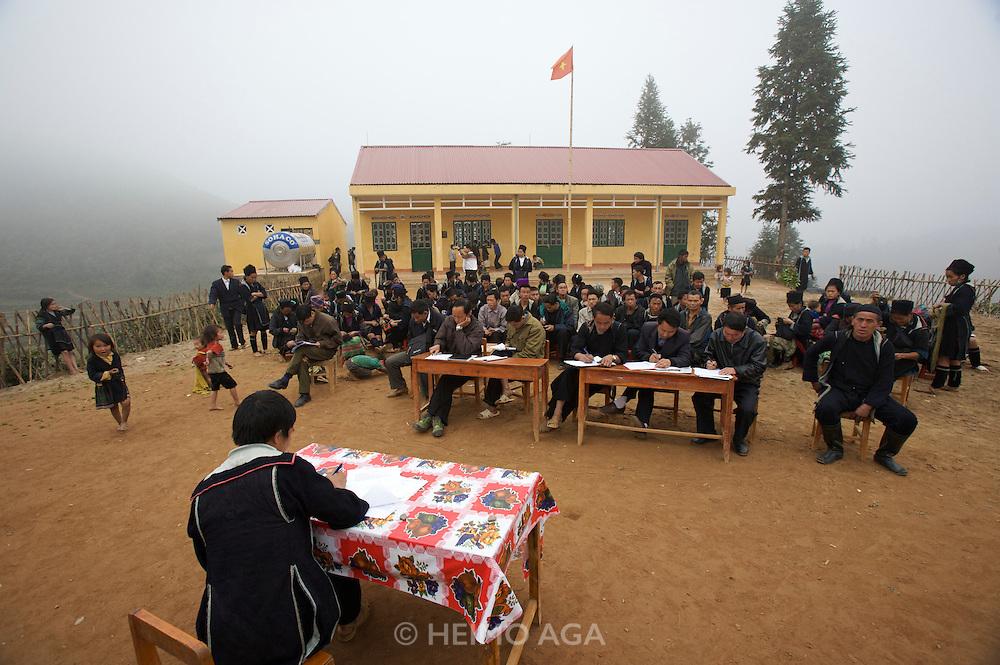 Hilltribe villages around Sapa. Adult Black Hmong taking literacy test.