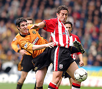 Photo: Daniel Hambury, Digitalspor<br /> Barclaycard Premiership. Wolverhampton Wanderes V Southampton   3/4//2004.  <br /> <br /> Wolves' Mark Kennedy and Southamptons' Paul Telfer