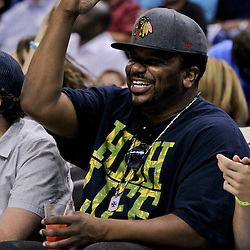 April 19, 2012; New Orleans, LA, USA; Actor Craig Robinson sits courtside during the second half of a game between the New Orleans Hornets and the Houston Rockets at the New Orleans Arena. The Hornets defeated the Rockets 105-99.   Mandatory Credit: Derick E. Hingle-US PRESSWIRE