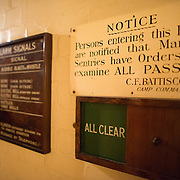 An All Clear indicator at the Churchill War Rooms in London. The museum, one of five branches of the Imerial War Museums, preserves the World War II underground command bunker used by British Prime Minister Winston Churchill. Its cramped quarters were constructed from a converting a storage basement in the Treasury Building in Whitehall, London. Being underground, and under an unusually sturdy building, the Cabinet War Rooms were afforded some protection from the bombs falling above during the Blitz.