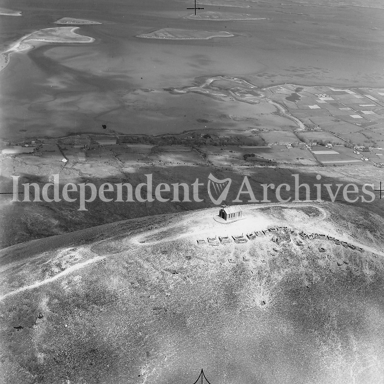 A141 Croagh Patrick.   05/09/53. (Part of the Independent Newspapers Ireland/NLI collection.)<br /> <br /> <br /> These aerial views of Ireland from the Morgan Collection were taken during the mid-1950's, comprising medium and low altitude black-and-white birds-eye views of places and events, many of which were commissioned by clients. From 1951 to 1958 a different aerial picture was published each Friday in the Irish Independent in a series called, 'Views from the Air'.<br /> The photographer was Alexander 'Monkey' Campbell Morgan (1919-1958). Born in London and part of the Royal Artillery Air Corps, on leaving the army he started Aerophotos in Ireland. He was killed when, on business, his plane crashed flying from Shannon.