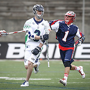 Matt Abbott #3 of the Chesapeake Bayhawks keeps the ball from Will Manny #1 of the Boston Cannons during the game at Harvard Stadium on April 27, 2014 in Boston, Massachusetts. (Photo by Elan Kawesch)