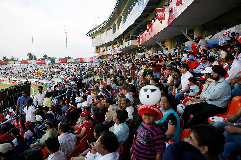 Crowd watches during match 9 of the Indian Premier League ( IPL ) Season 4 between the Kings XI Punjab and the Chennai Super Kings held at the PCA stadium in Mohali, Chandigarh, India on the 13th April 2011..Photo by Money Sharma/BCCI/SPORTZPICS