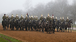 © Licensed to London News Pictures. 08/03/2013. London, UK. Cavalry soldiers of the Household Division are seen riding together on horseback through early morning fog in Hyde Park London today (08/03/2013). Photo credit: Matt Cetti-Roberts/LNP