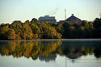 Fall sun illumiates Lake Raleigh trees on Centennial Campus.