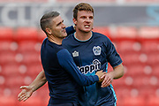 Bury defender Chris Stokes (3) celebrates winning the game with Bury manager Ryan Lowe during the EFL Sky Bet League 2 match between Swindon Town and Bury at the County Ground, Swindon, England on 15 September 2018.