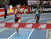 Feb 10, 2018; Boston, Massachussetts, USA; Kelsey Chmiel (left) defeats Gabrielle Wilkerson to win the junior girls mile, 4:44.84 to 4:46.95, during the New Balance Indoor Grand Prix at Reggie Lewis Center.