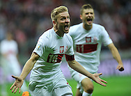 Poland's Jakub Blaszczykowski celebrates after he scored unrecognized  goal during the FIFA World Cup 2014 group H qualifying football match of Poland vs Montenegro on September 6, 2013 in Warsaw, <br />