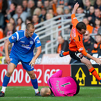 Dundee Utd v St Johnstone...25.09.10  <br /> David Robertson goes flying as Peter Enckelman saves th ball<br /> Picture by Graeme Hart.<br /> Copyright Perthshire Picture Agency<br /> Tel: 01738 623350  Mobile: 07990 594431