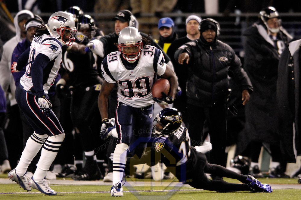 The New England Patriots running back Laurence Maroney (39) runs for a 36-yard gain in the 3rd quarter against Baltimore Ravens cornerback Samari Rolle (22) on December 3, 2007 at M&T Bank Stadium in Baltimore, Maryland.  The Patriots defeated the Ravens 27-24.