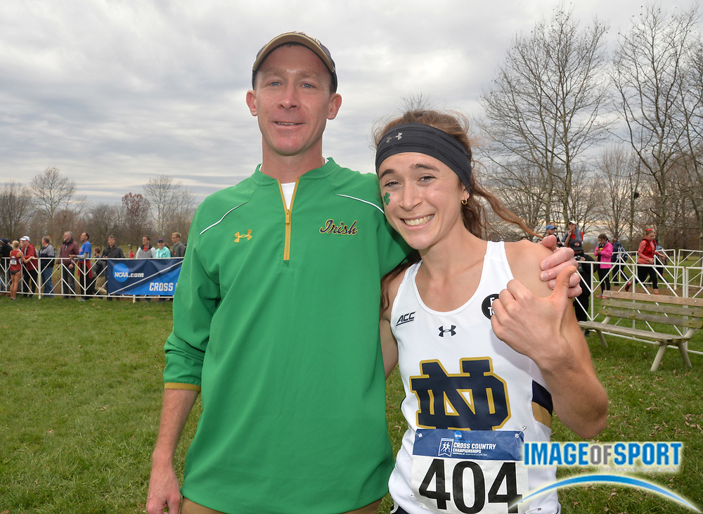 Nov 21, 2015; Louisville, KY, USA; Molly Seidel of Notre Dame (right) poses with coach Matt Sparks after winning the womens race in 19:28 during the 2015 NCAA cross country championships at Tom Sawyer Park.