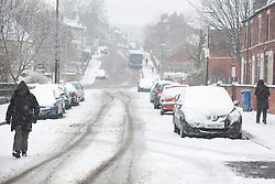 © Licensed to London News Pictures. 22/03/2013. Pitsmoor, Sheffield. The residents of Pitsmoor, Sheffield woke to a heavy snow again this morning. There is more snow forecast for the rest of the day and tomorrow in Sheffield. Photo credit : David Mirzoeff/LNP