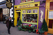 Brawn's florist shop in Westport, West Ireland, brightly painted in yellow and purple.