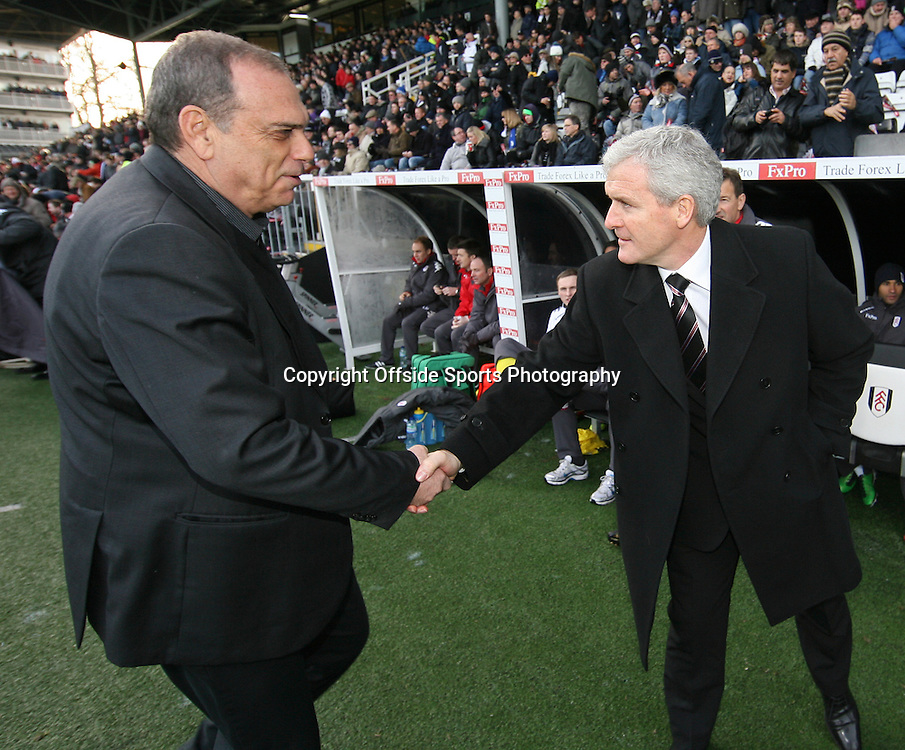 26/12/2010 - Barclays Premier League - Fulham vs. West Ham United - West Ham manager Avram Grant (L) shakes hands with Fulham manager Mark Hughes before the match - Photo: Simon Stacpoole / Offside.