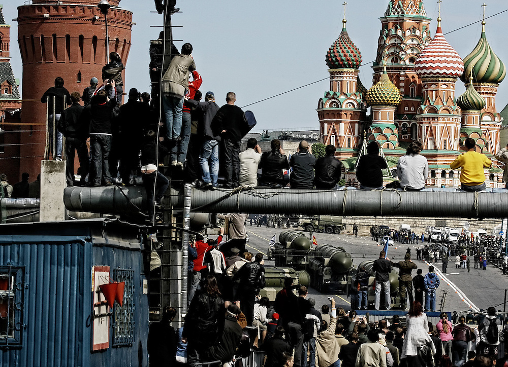 Muscovites find the nearest suitable vantage point to witness strategic missiles Topol-M leaving the Red Square during the military parade, devoted to the 63rd anniversary of the victory over Nazi Germany, Moscow, Russia 09 May 2008. Heavy military technics were shown for the first time in 17 years.