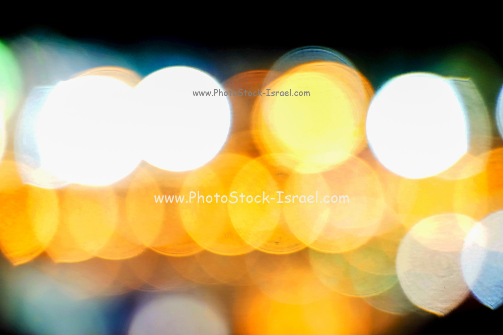 Abstract defocused colour lights in a dark black night