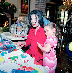 EXCLUSIVE: ** PREMIUM RATES APPLY ** Michael Jackson - who died 10 years ago today - poses with his children in this set of incredible and extraordinary family photographs. The exclusive images show the late singer posing at home in his Neverland Ranch with daughter Paris and son Prince when they are just toddlers. In other pictures Jackson is seen posing with former nurse Debbie Rowe who is the mother to Jackson's eldest children. The children are also pictured at the star's luxury home in Los Olivos, California, at a birthday party, riding on a fun fair ride and even taking a trip on a train that spanned a large area of the ranch. Other photographs in the set show Paris and Prince with their father in New York. A final shot shows Jackson cutting a solitary figure posing on his own in the grounds of his world famous home. Jackson died aged 50 on June 25, 2009 from acute intoxication from propofol given to him by his personal physician Dr Conrad Murray. 25 Jun 2019 Pictured: ) MJ/Paris/Blanket- Neverland- 2003. Photo credit: MEGA TheMegaAgency.com +1 888 505 6342