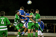 Ben Middleton (Captain) (North Ferriby United) is barged out of the way as Michael Ihiekwe (Tranmere Rovers), Andy Cook (Tranmere Rovers) and Jake Skelton (North Ferriby United) go for the header in the penalty box during the Vanarama National League match between North Ferriby United and Tranmere Rovers at Eon Visual Media Stadium, North Ferriby, United Kingdom on 21 March 2017. Photo by Mark P Doherty.