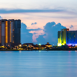 Pensacola Beach Florida skyline at sunrise panorama photo. Pensacola Beach is on Santa Rosa Island along the Emerald Coast in the Southeastern United States. Panoramic photo ratio is 1:3. Copyright ⓒ 2018 Paul Velgos with All Rights Reserved.