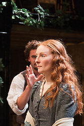 """© Licensed to London News Pictures. 21/11/2013. London, England. Pictured: Tom Bateman as Dante Gabriel Rossetti and Emma West as Lizzie Siddal. World premiere of the play """"Lizzie Siddal"""" at the Arcola Theatre, Hackney, London. The play tells the story of the woman who was 'Ophelia' in Millais' famous painting. Running from 20 November to 21 December 2013. With Emma West as Lizzie Siddal and Tom Bateman as Dante Gabriel Rossetti. Photo credit: Bettina Strenske/LNP"""