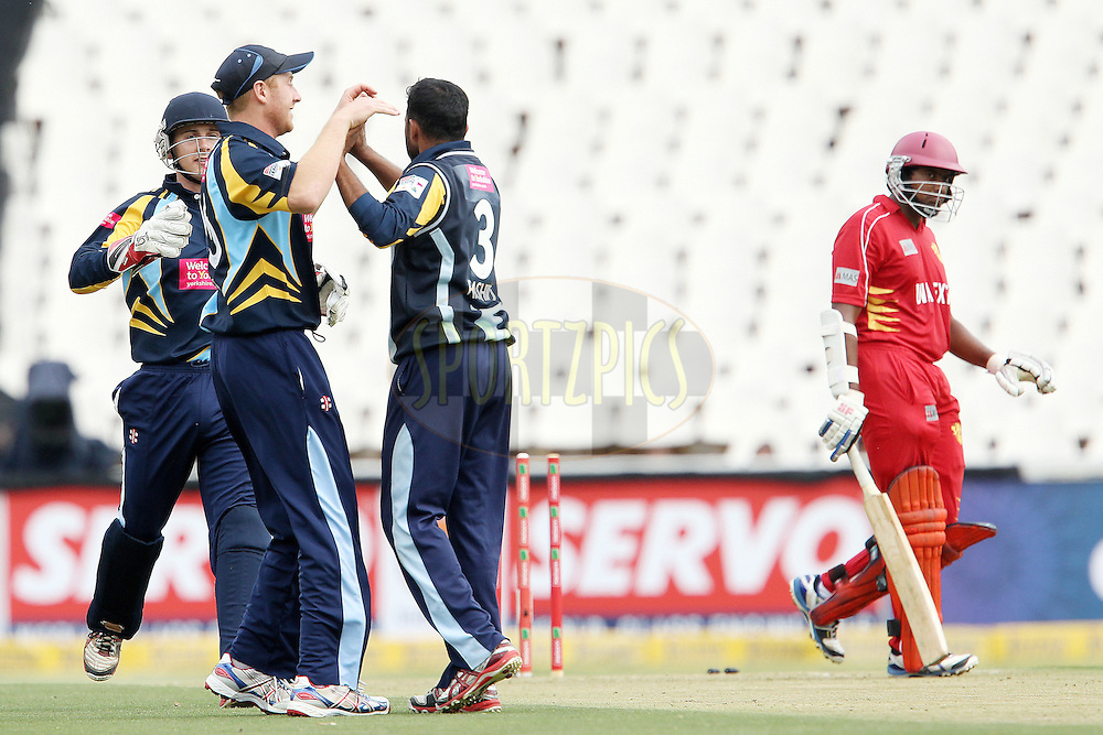 Adil Rashid celebrates the wicket of Bhanuka Rajapakse during 1st Qualifying match of the Karbonn Smart CLT20 South Africa between Uva Next and Yorkshire held at The Wanderers Stadium in Johannesburg, South Africa on the 9th October 2012..Photo by Ron Gaunt/SPORTZPICS/CLT20
