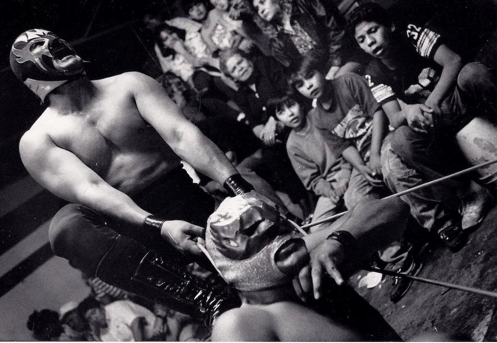 El Lucha Libre match at gym in Tijuana, Mexico.  1993
