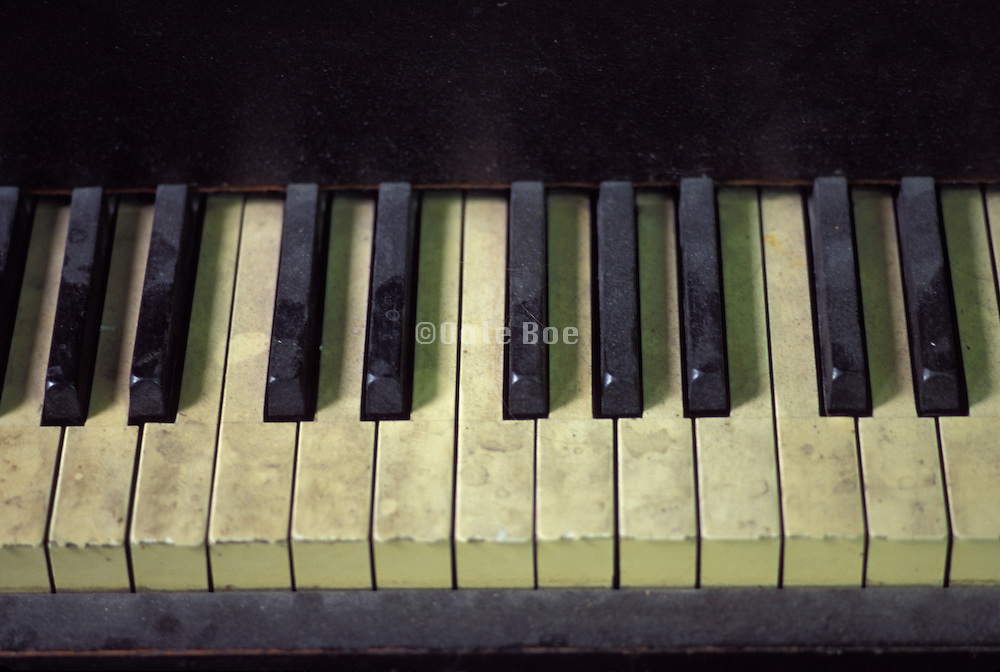 old piano with dust on it keys.