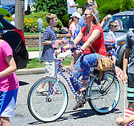 A woman rides an independence themed bicycle  during the Independence Parade Saturday July 2, 2016 on Beach Avenue in Cape May, New Jersey. Photo by William Thomas Cain/Cain Images