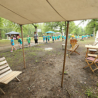 Students walk past a civil war camp site during Friday's Brice's Crossroads Discovery School Day.
