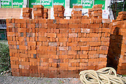 bricks arranged for construction in alley