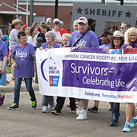 Cancer survivors open the Firday nights Relay for Life event with the ceremonial lap around the parking lot of Parkway Elementary School. Lee County Relay for Life is an annual team fundraising event that benefits the American Cancer Society. This years theme was Give Cancer the Boot.