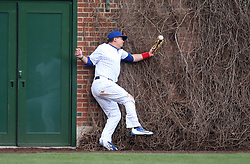 April 13, 2017 - Chicago, Illinois, U.S. - Chicago Cubs left fielder KYLE SCHWARBER makes a juggling catch on a hit that was ruled a double by the Los Angeles Dodgers' Enrique Hernandez in the third inning on Thursday, at Wrigley Field in Chicago. The Cubs won, 4-0. (Credit Image: © Brian Cassella/TNS via ZUMA Wire)
