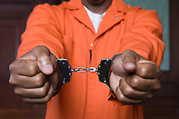 Handcuffed criminal in court