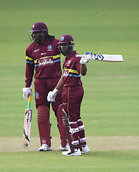 West Indies' Evin Lewis, (right) celebrates reaching his 50 alonside Chris Gayle during the special fundraising T20 International match at Lord's, London.