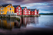 Namsos, Namdal, Trondelag, Norway, July 2015. Wooden stilted houses at the harbour of Namsos. Trøndelag lies at the heart of Norway's identity. The rolling hills of the interior with its traditional ox-blood coloured farm houses grow a wealth of produce. In the west the coastline is sculpted by a maze of fjords and islands home to small fishing communities. Photo by Frits Meyst / MeystPhoto.com