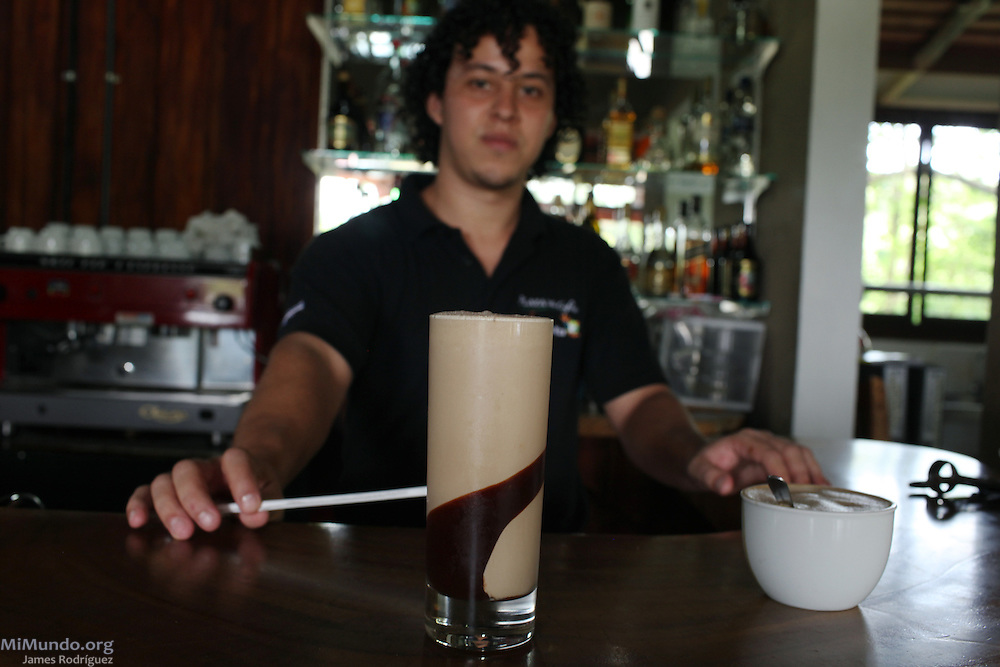 Marco Rodríguez Briseño, coffee shop server at COOCAFE's Plaza del Café Restaurant near the Arenal Volcano, prepares an iced coffee drink. COOCAFE, Tilarán, Guanacaste, Costa Rica. August 22, 2012.