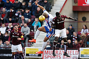 Kilmarnock FC Forward Josh Magennis jumping for the challenge  during the Ladbrokes Scottish Premiership match between Heart of Midlothian and Kilmarnock at Tynecastle Stadium, Gorgie, Scotland on 27 February 2016. Photo by Craig McAllister.