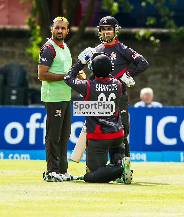 The second match of the second day of the T20 qualifiers in Scotland started off at te Grange Cricket Club , Edinburgh, between United Arab Emirates and Afghanistan. Abdul Sakoor takes on some liquid as the day turns humid. <br /> <br /> Ger Harley SportPix.org.uk 10 July 2015