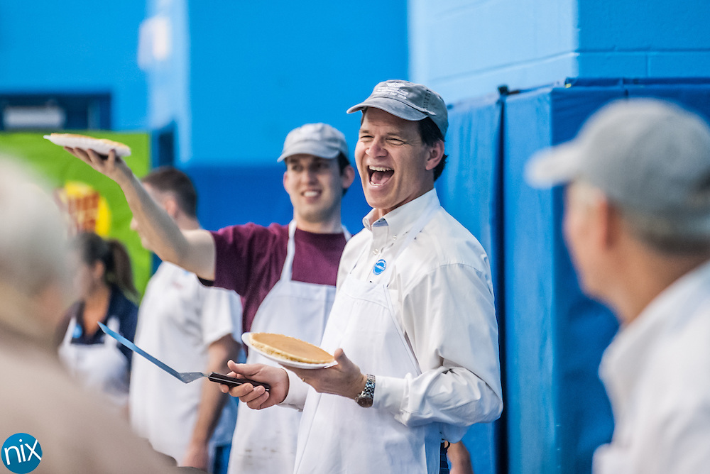 Marc Niblock laughs as he hands out pancakes during the annual Boys & Girls Club Pancake Day fundraiser Thursday morning in Concord.