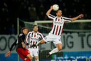 27-11-2010: Voetbal:Willem II:SC Excelsior:Tilburg<br /> Bergkamp (L) geeft Hallilovic een duw<br /> Foto: Geert van Erven