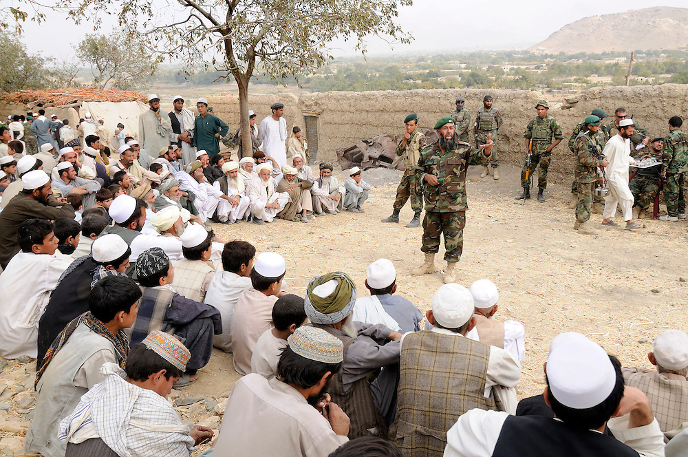 "The religious officer from the ANA 3rd Brigade, 201st Corps, speaks with villagers during an operation in Tagab Valley.....Colonel Haynes was firm about the Afghan's potential indicating they inherently understand COIN.  The ANA is a national army with each unit strictly reflecting the ethnic make up of the nation.  Unlike foreign forces they speak the same languages, understand the culture and people.  Haynes stated, ""Heck they even invented the corps religious officer who they use to relate to the people.  I never heard of it before, but I love it!""  Each ANA brigade deploys a religious officer, or mullah, who preaches to villagers the sins of supporting violent insurgent groups.   Unconventional innovative ideas like this are essential in COIN."